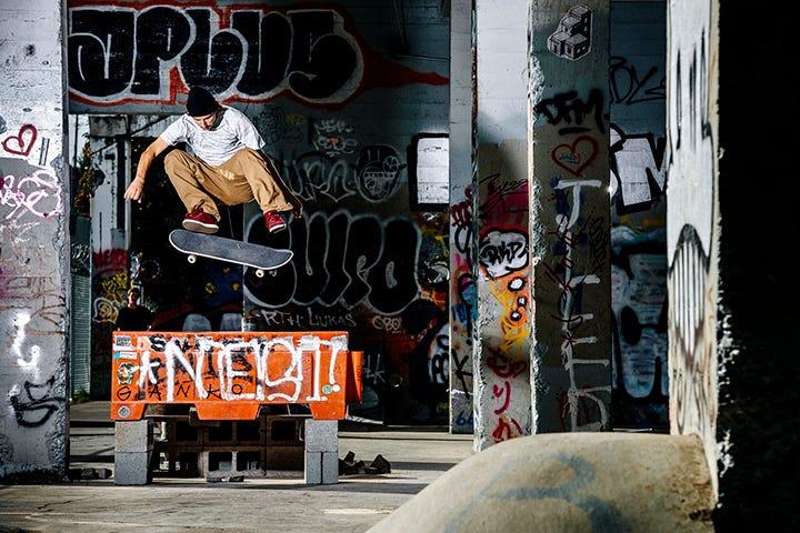 Tom Asta on skateboard jumping